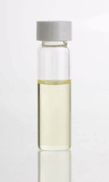 Glass vial of sandalwood oil
